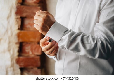 Man buttoning shirt. Businessman getting ready. Men's style.