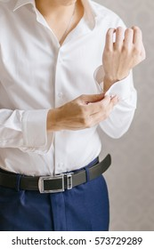 man buttons shirt, a man in a white shirt, morning groom, hands of a man close-up, a white shirt on a businessman, man buttons shirt sleeve, businessman puts on a suit