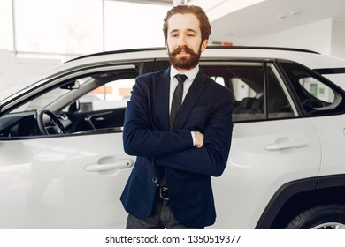 Man buying the car. Businessman in a car salon