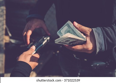 Man buying a gun for money