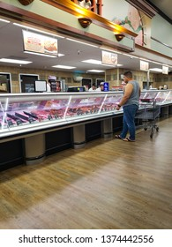 Man buying meat from a butcher in Stater Bros supermarket at Perris.california .usa.April 7,2019