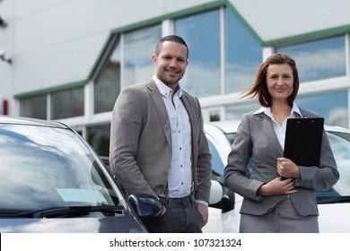Man buying a new car in a garage