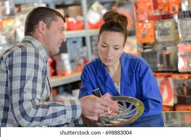 man buys brake wheel in auto parts store