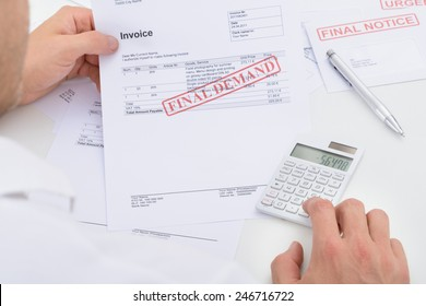 Man Calculating Invoice With Final Demand Notification