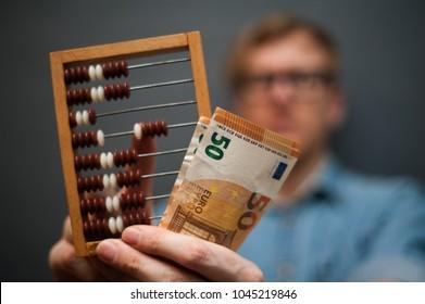 Man calculating money