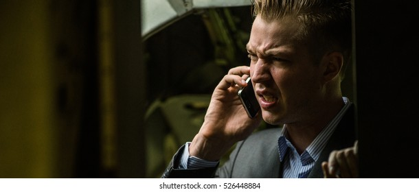 Man calling in a airplane
