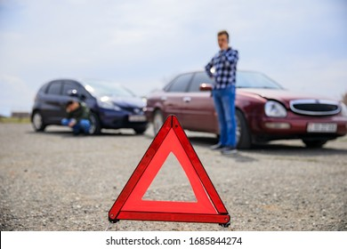 Man calling and car crash on the road