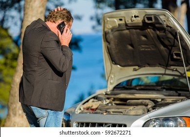 A man calls for help to repair the breakdown the car on the road
