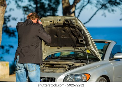 A man calls to service for help to repair the breakdown the car