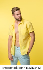 Man calm face posing confidently yellow background. Guy wear unbuttoned shirt with smooth skin on chest. Hair removal procedure. Take off clothes and not be ashamed. Male hair depilation chest.