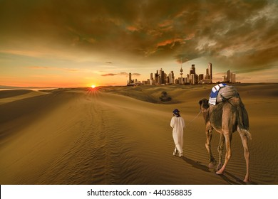 A man with a camel walking in the middle of the desert towards the kuwait city