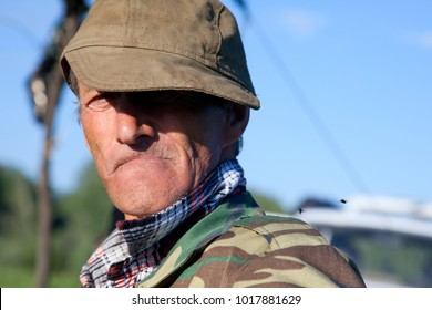 A man in a camouflage against the blue sky