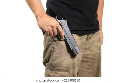 Man in a camouflage pants holding a gun isolated on white background, Army, Semi-automatic handgun, 45 pistol.