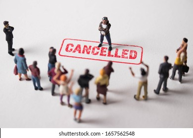 Man with cancelled stamp in front of angry mob. Person is the latest victim of toxic cancel culture. Guy is bullied or excluded by friends, family, social media followers. Angry, offensive dude.
