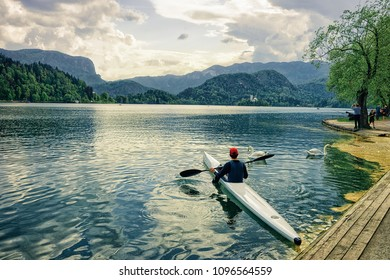 Man canoeing on Bled Lake, Slovenia