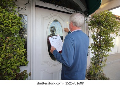 Man Canvassing a neighborhood taking a poll