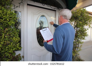 Man Canvassing a neighborhood taking a survey