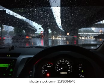 man in car looking the traffic in raining time