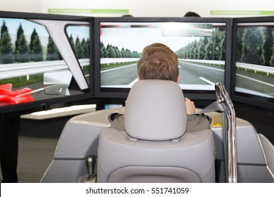 Man in a car simulator to study safety and reflexes