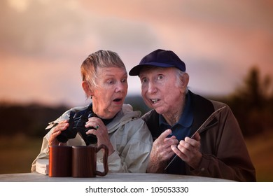 Man with card talks to woman holding binoculars