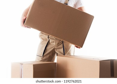 Man with cardboard box in hands. Relocation services. Mover with boxes. Loader