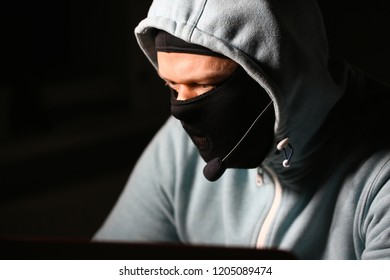 Man carder in mask connect to darknet search information bank system pc crack dark web uses stolen credit card cloud buy illegal services