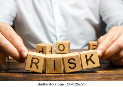 The man carelessly raises the word Risk. High risks in business, fragile balance and insecurity. Caution and anticipation of possible problems and shocks. Planning and action strategy. Analytics