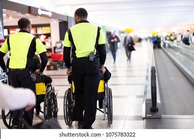 Man caretaker pushing elderly people in wheelchair in the airport