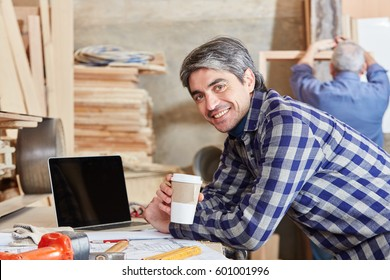 Man as carpenter taking a coffe break and relaxing