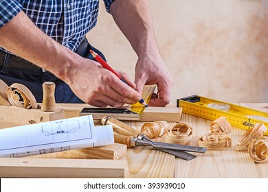 Man with carpenters tools construction concept.