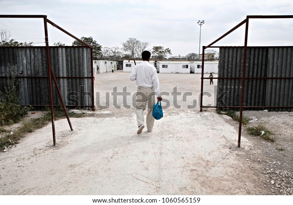 A man carries a plastic  bag at Eleonas refugee camp in Athens, Greece on Apr. 9, 2016