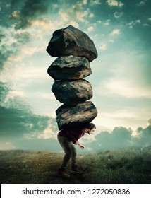 Man carries a stack of heavy rocks.