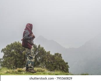 A man carring a kalashnikov in Semien mountains, Ehtiopia.