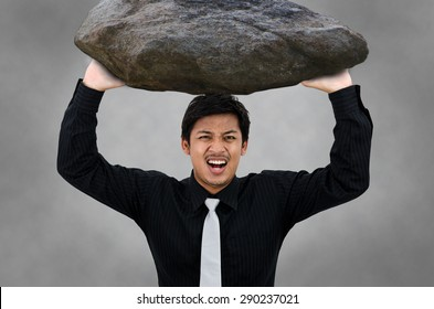 Man carry the rock and stress action.