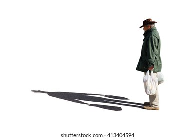 Man carrying bags with shadows