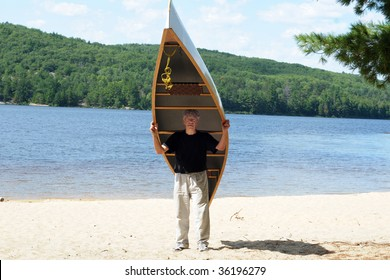 Man carrying a canoe