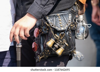 Man carrying different steampunk accessoires