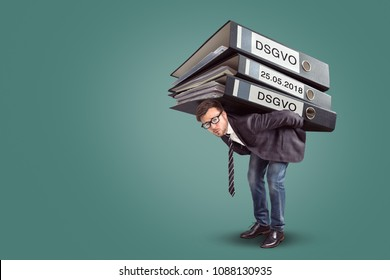 Man carrying an enormous stack of DSGVO files