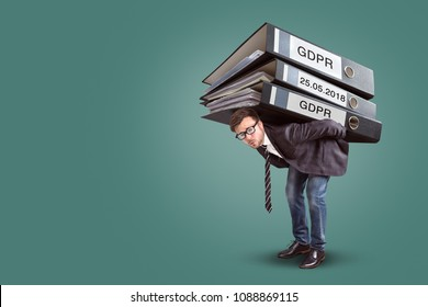 Man carrying an enormous stack of GDPR files