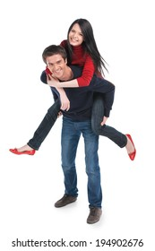 Man carrying girlfriend on his back. happy couple playing on white background