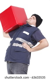 man carrying an heavy and red cube with pain on his back