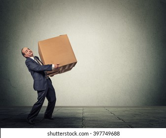 Man carrying large heavy box
