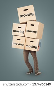 A man is carrying many moving boxes - isolated on a neutral background
