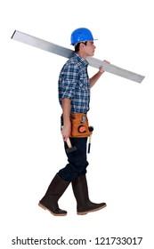 Man carrying metal beam
