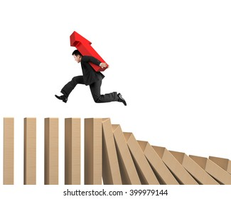 Man carrying red arrow up sign running on falling wooden dominos, isolated on white background.