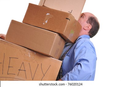 Man carrying several heavy boxes, straining to keep them lifted and balanced. Shot on a white background.