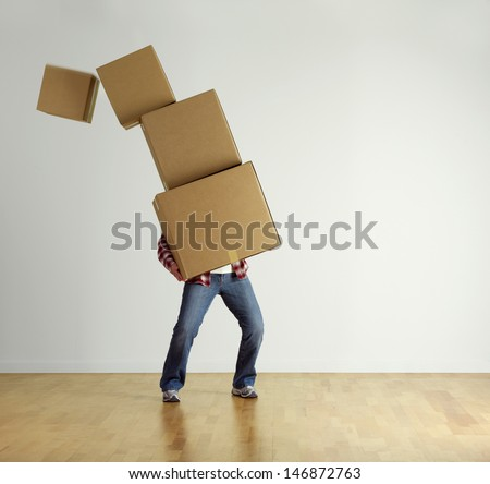 man carrying stacked boxes on moving stock photo edit now