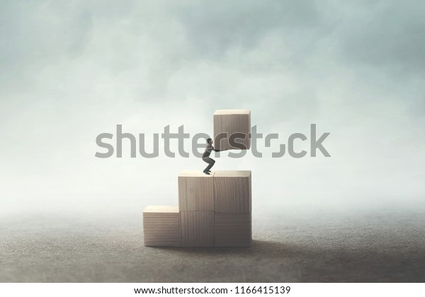 man carrying wooden block to build his future