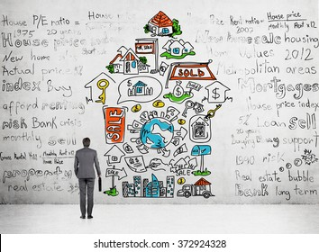 Man with a case in hand standing in front of a concrete wall with different words written and a number of icons depicting opportunities provided by money arranged in an arrow.Concept of spending money