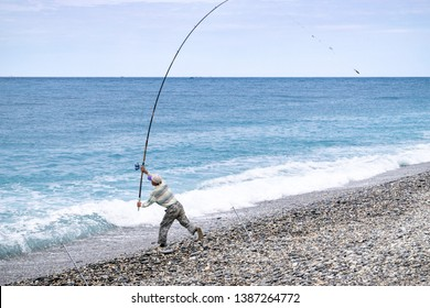 Man casting his fishing line along Hualien Beach - Hualien County, Taiwan